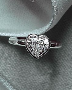 Simple and sweet heart engagement ring.