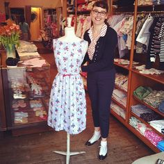 Rachel Riley Dressing the mannequin with the Strawberry Print Dress!