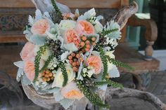 Bridal Bouquet using Juliet Garden Roses,  White Roses, Bouvardia, Peach Hypericum, Silver Brunia and Lysmachia finished with Dusty Miller #flowersbyea