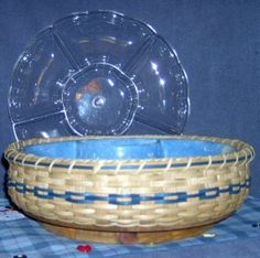 "Let's Party! Lazy Susan Basket Pattern  $1.50 - By Debby Krzyston  Woven with an 8"" for $15.50 or 12"" for $22.50 Round Lazy Susan Base. Price Includes Plastic Tray Insert.. Contact us on BasketBees.com to purchase this pattern and slotted basket base."