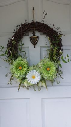 "Welcome your guests into your home with this amazing Gerber daisy and hydrangea floral wreath! This rustic, grapevine wreath is done monochromatically in greens but can be customized to your liking! Available in 3 sizes, all custom made.   ***All orders are made to order and may vary slightly from the picture. Contact me to start your custom order. ***Expedited orders are available for an additional charge. See listing for ""Jump to the head of the line"" ***Expedited shipping is available for…"