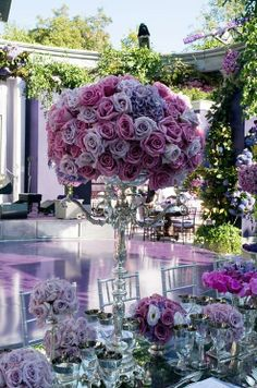 I like the large centerpiece and smaller bouquets surrounding it.
