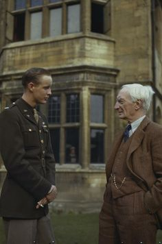 Lieutenant James F Gaylor of the 8th United States Army Air Force, talking to the Master of University College, Oxford, Sir William Beveridge. Lieutenant Gaylor, a fighter pilot from Texas, was in hospital at Oxford after his eardrums were injured in a dog fight, and was a guest at one of the regular tea parties given by Sir William and Lady Beveridge for American troops.