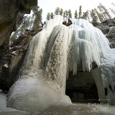 Queen of Maligne is an art print of a frozen waterfall in Maligne Canyon Jasper National Park.