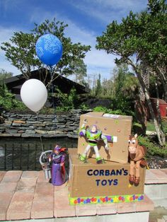Toy Story, Characters r ready to take action! Easy enough, very inexpensive if you have the toys already and great backdrop for taking photos.