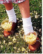 relay race with a bowl of something wrapped on your foot!