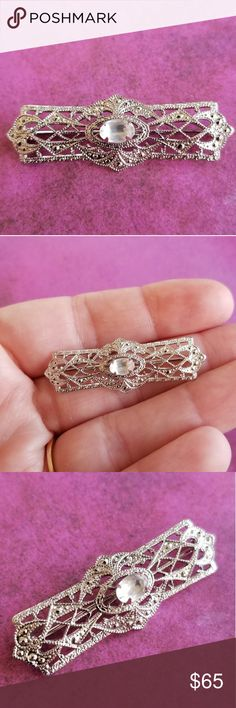 Vintage Sterling Silver bar pin 925 filigree brooc This lovely little vintage brooch is made of solid Sterling Silver with a bright finish. It has a lacy filigree Art Deco revival design set with a sparkly clear gem in the center. It is signed STERLING TK on the back (t and k are joined) which seems to be the signature  of the Tru-Kay jewelry company. This pin is in great shape and is from a smoke free home:)  8841tk9s8s Vintage Jewelry Brooches