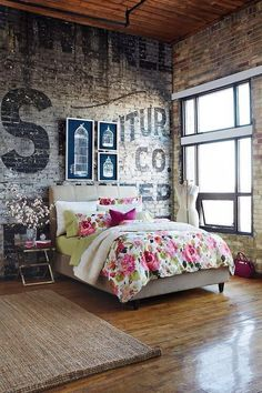 brick wall, typography lettering, wood planked ceiling, sisal area rug, feminine bold floral bed covers