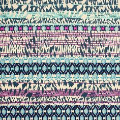 "Teal Magenta Animal Ethnic Cotton Jersey Blend Knit Fabric - A unique animal tie dye  with ethnic rows in teal blue, magenta, and turquoise blue design on a soft, neutral taupe color cotton jersey rayon blend knit.  Fabric is lighter weight, with a nice drape and stretch.  Diamond design measures 1 3/4"" for scale.  ::  $6.25"