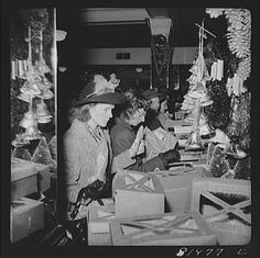 Vintage Christmas Photograph ~ Women Christmas Shopping at a Woolworth's Store in Washington, D.C. in 1941. ~~Notice the pine cone ornaments and the foil-covered bells.