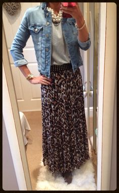Leopard print maxi skirt with grey sweatshirt & denim jacket accessorised with chunky pearl necklace.