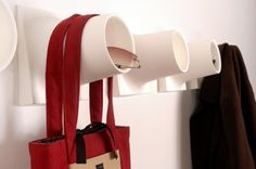 Cubby hooks are a great alternative for hanging kids stuff...no sharp edges to poke them!