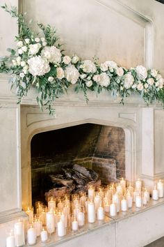 Wedding This wedding ceremony mantel design included white hydrangea, fluffy white ranunculus, lisia White Wedding Flowers, White Flowers, Floral Wedding, White Hydrangeas, Purple Wedding, Candles In Fireplace, Pillar Candles, Fireplace Mantel, White Candles