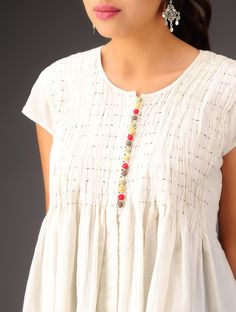 https://www.jaypore.com/cream-red-yellow-green-with-multi-color-buttons-riva-top-cotton-p55806