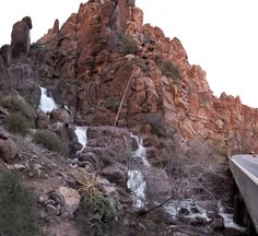 10. Queen Creek Waterfall runs down a rocky slope right beside US 60. See it in the lower right side of the photo?