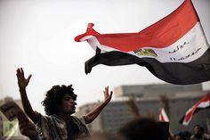 Egyptian protesters wave their national flag as they shout political slogans against President Mohamed Morsi′s decree granting himself broad powers during a demonstrations in Cairo′s Tahrir Square on November 27, 2012. (AFP Photo / Gianluigi Guercia)