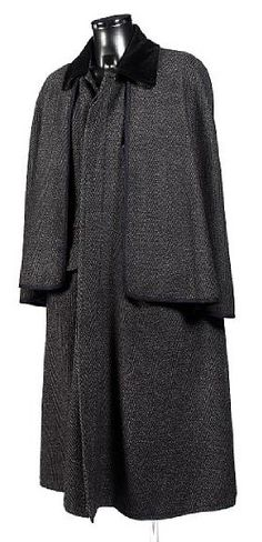 Inverness Cape: full cape covering shoulders and arms, arm holes