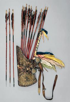 Warriors of the Himalayas    Quiver and Arrows Tibetan, 17th–18th century Leather, iron, gold, silver, wood, shellac, pigments,  cane or bamboo, feathers, textile Quiver, L. 18½ in. (47 cm), W. 10 5/8 in. (27 cm); arrows, L. 35 3/8 in. (89.9 cm)  On loan courtesy of the National Museum of Scotland,  Royal Museum, Edinburgh (