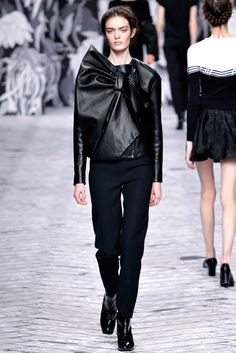 Big Bows and leather. delicious! this one is by Viktor & Rolf - fall 2013