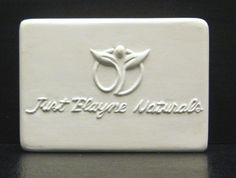 """Just Elayne Naturals Soap Bar Plaster Prototype. Rectangle shape, rounded edges and slightly rounded corners with raised artwork and/or company logo. 3.5"""" long x 2.5"""" wide x 1.1875"""" thick. Company located in Ohio, United States."""