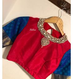 Gorgeous red and blue color combination high neck blouse with jewel theme hand detailing. Silk Saree Blouse Designs, Fancy Blouse Designs, Bridal Blouse Designs, Blouse Neck Designs, Blouse Styles, Blue Color Combinations, Saree Trends, High Neck Blouse, Indian Blouse