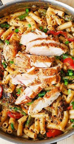Chicken Alfredo Pasta with Bell Peppers Asparagus in a Creamy Sun-Dried Tomato…
