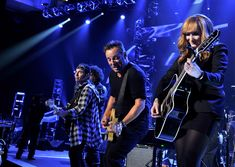 Bruce Springsteen Photos - Honoree Bruce Springsteen (2nd-L) and musician Patti Scialfa perform onstage at MusiCares Person Of The Year Honoring Bruce Springsteen on February 8, 2013 in Los Angeles, California. - The 55th Annual GRAMMY Awards - MusiCares Person Of The Year Honoring Bruce Springsteen - Show
