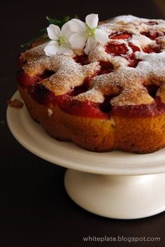 strawberry cake...this reminds me of a cake my God Mother used to make, except with cherries:) Miss her...