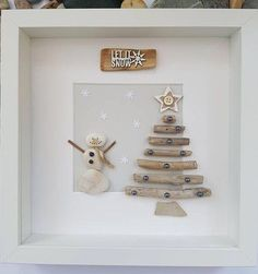 Pebble art picture of snowman next to driftwood christmas tree, unique gift, birthday, home decorThanks handofbod for this post.A beautiful and unique handmade beach pebble picture of snowman next to driftwood Christmas tree with driftwood si# Art # Christmas Pebble Art, Driftwood Christmas Tree, Christmas Rock, Stone Crafts, Rock Crafts, Holiday Crafts, Beach Rocks Crafts, Sea Glass Crafts, Sea Glass Art