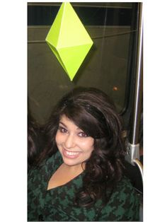 For a quick costume, make a giant green diamond out of paper, glue it onto a piece of wire, and attach it to a headband to look like a character from The Sims.
