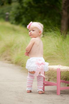 Your little one will feel like a royal princess in this lace-decorated, ruffled bloomer that is topped with a pink bow. The stretchy waistband and legs ensure easy changing for those little girls on the go!