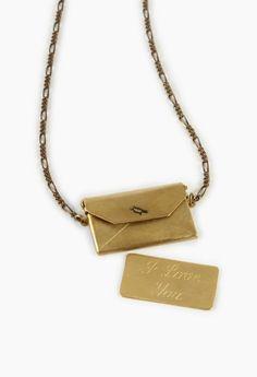 "Vintage envelope necklace and ""I Love You"" letter inside. Cute!"