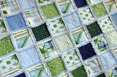 I'm usually not a fan of the frayed edge process....but the color combinations on this are so excellent that the rough edges look like little clouds beeping through between the patches. Quilt by Miadolce Originals