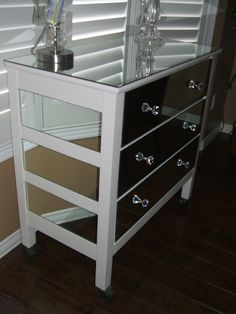 An old dresser I refurbished.  Painted and covered in mirror.