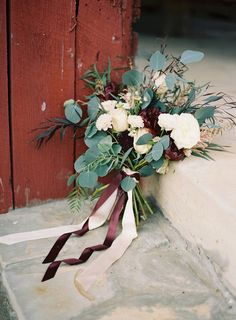 Fall bridal bouquet with whites and greens only and cooper ribbon.