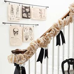 Really easy to DIY: Suspend ghoulish artwork from curtain rods that were enlarged medical textbook clip-art images. The embellish railings with garlands are crafted from layered 4  8-inch doilies and coffee filters.