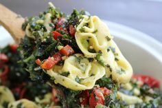 Kale & Tortellini Pasta Salad made with fresh kale, roasted red pepper, shallots and garlic, tortellini pasta and a lemon pesto dressing.