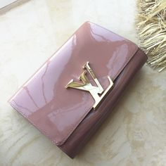 353b016f4005 Louis Vuitton Louise sobe rose clutch Gently used. Lightly wear marks.  Purchased