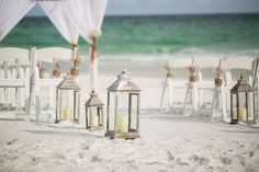 Lanterns as aisle decor // Photographer: Amy Little Photography / Reception Venue: Palazzo Del Sol / Wedding Planner/Coordinator: Serene Occasions // See more: http://theeverylastdetail.com/rustic-chic-pink-burlap-wedding/