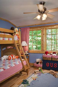 This custom cedar bunk bed perfectly compliments the cedar trim in this childs' room.