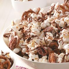 """Zebra"" Striped Chocolate Popcorn Recipe ""For a bake sale last year, I wanted to try something different. I'd seen chocolate popcorn in a candy shop and thought I'd try making it. This recipe was a great success."""