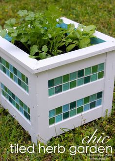 Use tile to add pizzazz to a pre-made wooden planter. What a great idea!