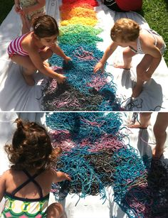 Use food coloring to add color to spaghetti noodles then lay the colored noodles out on a large white tarp for edible and squishy sensory play!