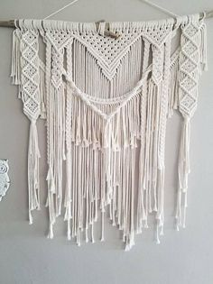Whether you're drawn to rustic elegance or bohemian tapestry; this macramé wall hanging will add the perfect touch of texture and charm to any living space. Created from California driftwood and soft cotton rope. This item is made to order and will vary slightly from the photos above. I do