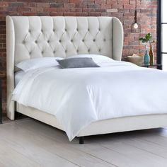 Check here first- cheaper if on sale!  Free Shipping!  Skyline Furniture Wingback Tufted Linen Diamond Upholstered Panel Bed in Talc