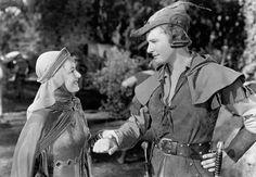 """Olivia de Havilland and Errol Flynn in """"The Adventures of Robin Hood"""", movie, 1938."""