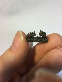 Item of the WeekThis incredibly tiny sculpture was hand cast in bronze! These two mice only measure 11/16th long, 3/8th tall, and ¼ of an inch wide. The detail is incredible- they even have a distinct eyes, noses and mouths. $25 USD