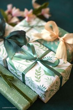 Download our printable botanical gift wrap for your spring gift giving, featuring lush green watercolor leaves and tiny white wildflowers.