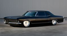 1964/65 Buick Riviera Custom - While I prefer my Riviera's a little milder, it does highlight what great lines these cars have. Once again, another great piece of Automotive Design, which, when refreshed with a more modern stance and rims, simply oozes the ever-elusive 'Road Presense' - Oh, btw, the reason it's classified 1964/65 is because it has a '65 front end on a '64 body. Very nicely done. Check the link for the equally nicely handled all-digital interior. I LOVE these cars...K