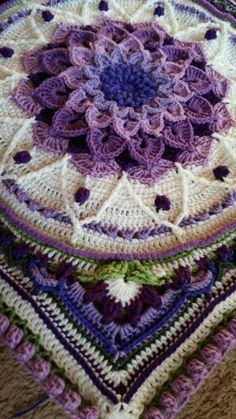 Shown on FB by Tina Zimmerman, Enchanted Garden Tote (center of afghan blanket) pattern on Ravelry   NOTE This tutorial is to be used in combination with both the Crocodile Flower Square pattern by Joyce Lewis, and the Sophie's Garden pattern (parts 2-4 of Sophie's Universe) by Dedri Uys (read and connect on Ravelry)